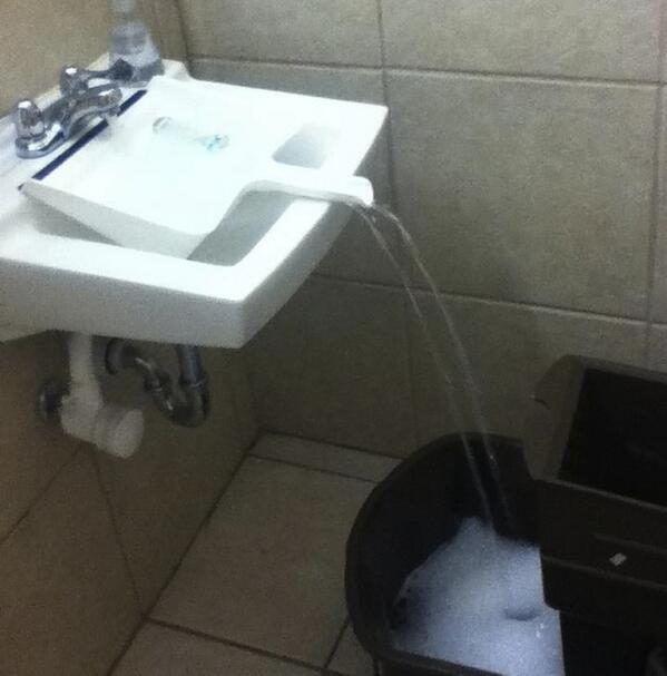 15. A dustpan in the sink can help you fill up buckets that don't fit.