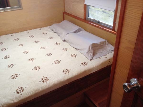 The master bedroom, located in the back of the bus.