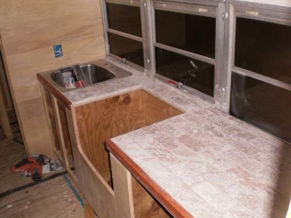 Stone tile was chosen for the countertops.