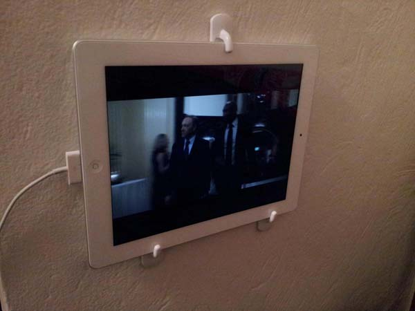 14.) 3M hooks are an awesome way to hang up your iPad and make a tiny TV screen.