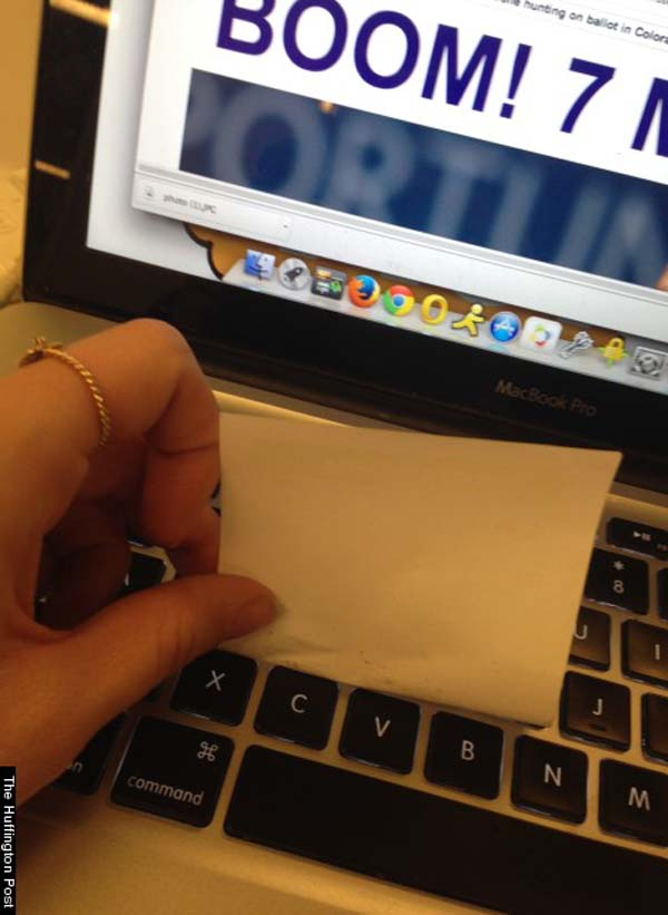 12.) Use a sticky note to clean your keyboard.