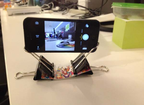 4.) Two binder clips and a business card can make an iPhone tripod.