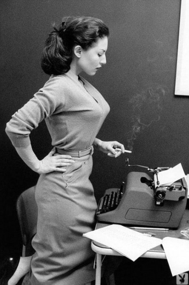 Girl with typewriter and a smoke.
