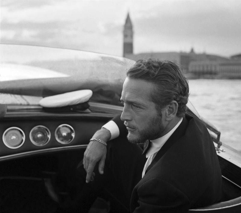 6 time Golden Globe winner Paul Newman boating in Venice during a film festival (1963).