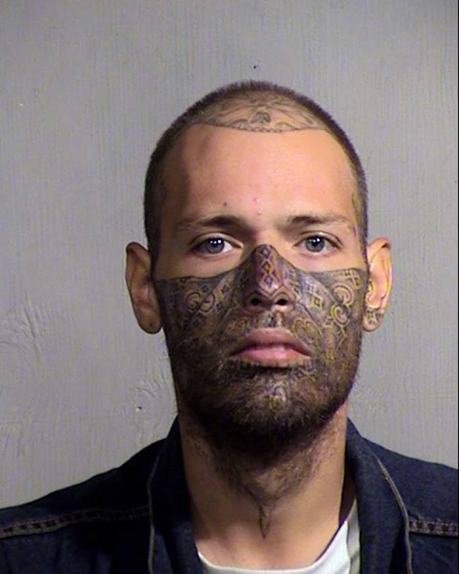 Did he tattoo a ski mask on his face?