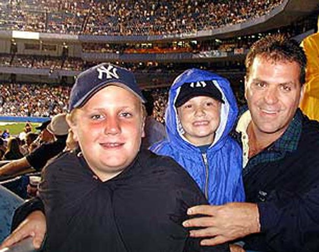 Joe Kelly with his two sons at Yankee Stadium on September 10, 2001. Kelly was killed the next day during the attacks on the Twin Towers.