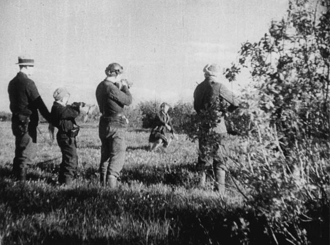 Soviet guerrillas executing a traitor behind German lines in 1944.