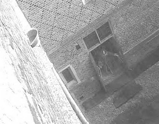 This supposed picture of the Hampton Court Ghost might look convincing, but is clearly fake. If you look closely, you can see that the ghost is wearing sneakers.
