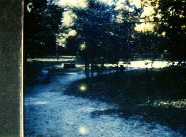 The three dots of light on this photo indicate that the film was expired when it was used.