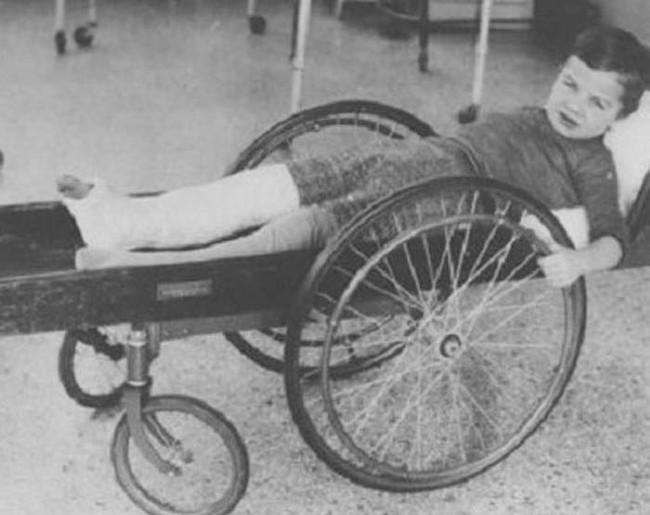 This injured boy is wheeling around in an