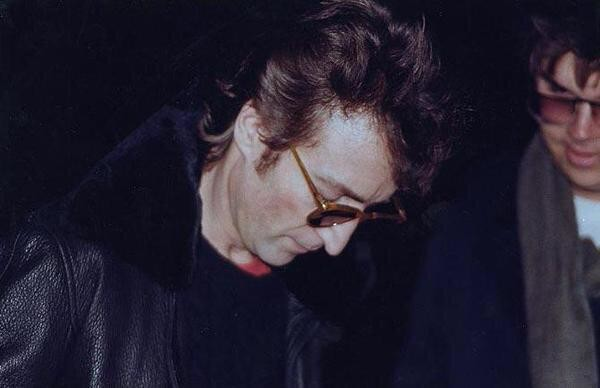 The last person to be photographed with John Lennon was Mark David Chapman...who was also his killer.