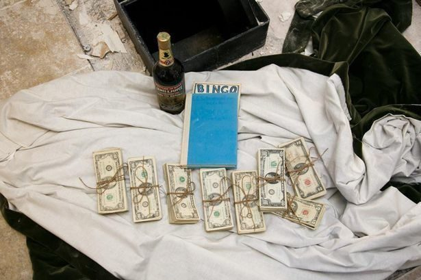A couple found this 50-year-old safe hidden in the wall with $51,000 inside. It also held a bottle of bourbon and a book titled A Guide for the Perplexed by E.F. Schumacher.