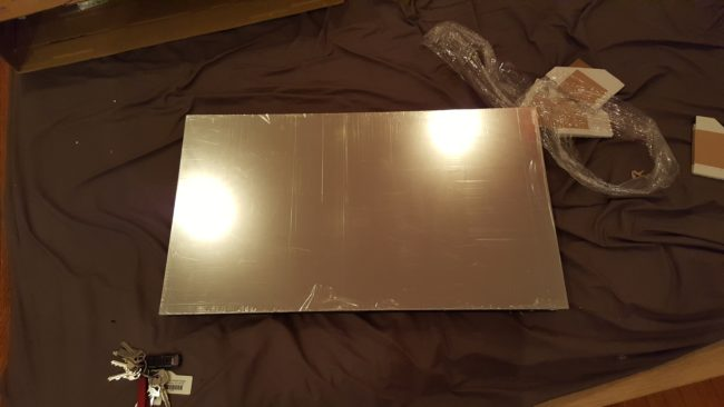 First, he bought a double-sided acrylic mirror.