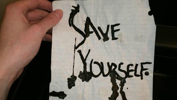 """Save Yourself"" in dripping ink. WHAT? That's enough for me to get out of there."