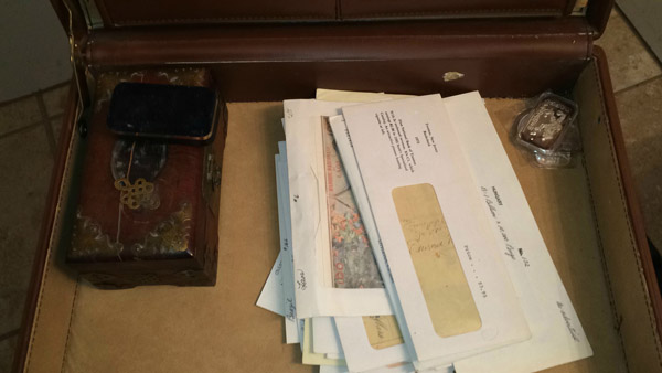 Inside: Old wooden box, jewelry box, envelopes with paper money of various countries and origins, 4 1 oz silver ingots.